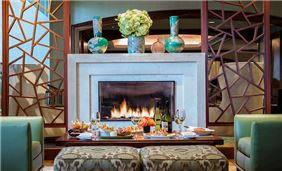Enjoy dinner by the fireplace in TAMO Bistro + Bar